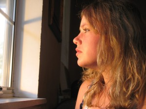 Girl staring out window - Seasonal affective disorder causes depression